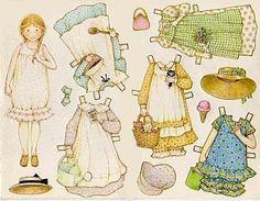Descargar gratis muñeca de papel con vestidos y accesorios.