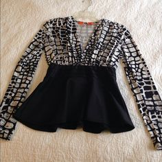 Black and White Peplum Top Worn a handful of times. Great condition, no damage. Tops