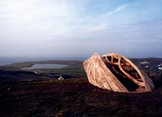 """""""Whalsay"""", built on the remote island of Whalsay in Shetland, Scotland, this sculpture forms its own sheltered space in a hostile environment. Elm with concrete foundations and steel fixings, length 7 meters, 2001"""