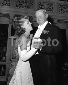 John Spencer-Churchill, 10th Duke of Marlborough and eldest son of Consuelo Vanderbilt, dances with his grand daughter, 18-year-old Serena Mary Churchill Russell, at the belated 21st birthday party ball for the Duke's youngest son, Lord Charles Colin Spencer-Churchill at Blenheim Palace, Woodstock, Oxfordshire 14 Jul 1962.