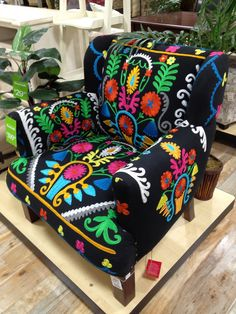 Bohemian folk-art armchair -- I like the bright colors and floral pattern on a black background. (Chair from Homegoods, shown on Bohemian Decor « Sheri Martin Interiors)