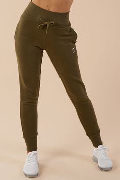 With a flattering high waisted fit, adjustable waistband and cuffed ankles, the High Waisted Joggers are the ultimate women's bottoms – consistently comfy and effortlessly cool. Stay snug, with super soft cotton blend material. Now available in Khaki.