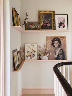 Vintage art creating a gallery wall on a Ikea picture ledge painted pink. Hallway Art, Hallway Ideas Entrance Narrow, Pink Hallway, Modern Hallway, Ikea Hallway, Hallway Shelving, Shelves, Ikea Picture Ledge, Mosslanda Picture Ledge