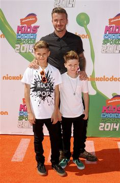 David Beckham and sons Cruz Beckham and Romeo Beckham arrive at the Nickelodeon Kids' Choice Sports Awards in Los Angeles on July 17, 2014.