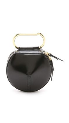 A sculptural 3.1 Phillip Lim clutch in a circular silhouette. The petite piece is styled with a two-way wraparound zip and a structured handle. - 3.1 Phillip Lim Alix Circle Clutch