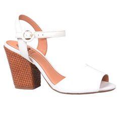 Sandália de couro croco e couro floter na cor branca. Salto de 9,5cm forrada de tressê caramelo, sola de borracha TR.<br />