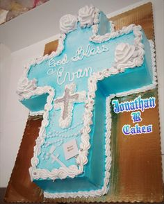 flowers and trim Cross Cake for a Boy Baptism Christening or First Communion God Bless Boy Cake Boy Communion Cake, First Communion Party, Cross Cakes, Boy Or Girl, Baby Boy, Christening Cakes, Order Cake, Boy Baptism, Specialty Cakes