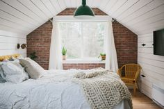 This Couple Turned Their Attic Into a Master Suite They Never Want to Leave:  Why use your attic for storage when you could create a cozy retreat like this?