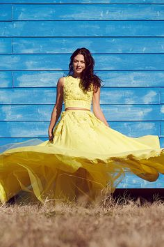 Beautiful blue and yellow contrast in front of the Shack Up Inn in Clarksdale, Mississippi. Crop top and skirt by Zuhair Murad. Photography by William Hereford. | Garden & Gun
