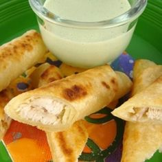 Chicken Taquitos made with White Corn Tortillas, not deep fried. Served with Cilantro Cream Dipping Sauce.