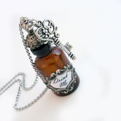 Steam punk - Alice Drink Me Bottle Pendant with Key. $42.00, via Etsy.