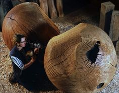 Carved Spheres by Alison Crowther. Alison designs and makes furniture and sculpture from her studio at the foot of the West Sussex Downs. Choosing exclusively English oak, she sources her timber from woodlands that are managed to the highest standards and which are continually renewed. She works ethically, carefully considering the implications that her work and working methods have on the environment.