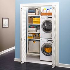 Stacked washer and dryer & clothes storage for the back bedroom. Closet in hallway