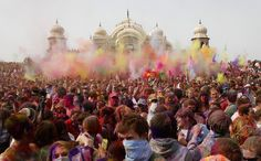 People throw colored powder during Holi, the festival of colors, at the Sri Sri Radha Krishna Temple in Spanish Fork, Utah March 26, 2011.   REUTERS/Jim Urquhart