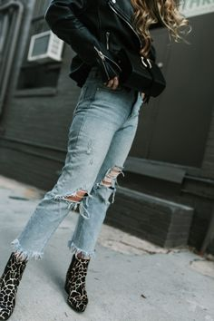 Shannon Jenkins from Upbeat Soles styles an edgy weekend outfit with distressed Levis, metallic booties, leather moto jacket, and velvet bodysuit
