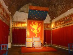 Note the tapestry behind the thrones, with a canopy effect as the gold stars on the blue field are suspended above their heads.  This would be a nice effect above the baron and baroness.