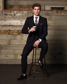 Consider teaming a black three piece suit with a white dress shirt to ooze class and sophistication. Throw in a pair of black leather loafers for a more relaxed aesthetic. Shop this look on Lookastic: https://lookastic.com/men/looks/three-piece-suit-dress-shirt-loafers/21175 — White Dress Shirt — Black Plaid Tie — Burgundy Polka Dot Pocket Square — Black Three Piece Suit — Black Leather Loafers