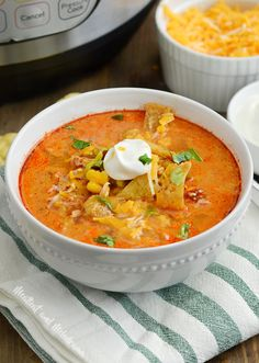 Instant Pot Chicken Enchilada Soup is quick and easy to make in the pressure cooker. Its loaded with chicken corn green chiles and diced tomatoes in a light creamy red enchilada sauce and perfect when youre craving a chicken soup recipe with extra spice! Chicken Enchilada Soup, Chicken Soup Recipes, Chicken Enchiladas, Enchilada Sauce, Taco Soup, Instant Pot Dinner Recipes, Pressure Cooker Recipes, Clean Eating Snacks, Have Time