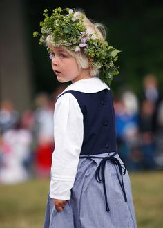 en liten flicka ... participating in one of the many Midsommer celebrations that occur all over Scandinavia during the summer soltice.
