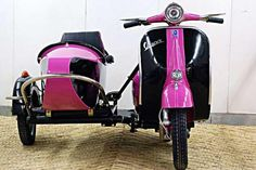 With the beautiful weather- all I can see myself doing is buzzing around in a Vespa like this -puppy in tow :)