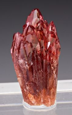 Rhodochrosite. Love the shades of red and pink this mineral can be.