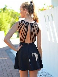 Distinctive backs on rhythm dresses are great because during most of your dancing the judges will only see your back. This dress is also tight with a swishy skirt, which emphasizes hip motion. It would make an even better newcomer or bronze ballroom costume if it was in a brighter color to contrast the lead's black pants.  #weightloss #health #weight loss