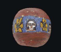 A ROMAN MOSAIC GLASS BEAD  CIRCA 1ST CENTURY B.C.-1ST CENTURY A.D.