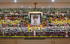 December 20, 2017:  The portrait of Kim Jong-Hyun, a 27-year-old lead singer of the massively popular K-pop boyband SHINee, is seen on a mourning altar at a hospital in Seoul.