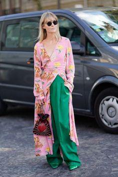 PARIS, FRANCE - SEPTEMBER 29: A guest wears a floral print kimono dress, green pants, outside Nina Ricci, during Paris Fashion Week Womenswear Spring/Summer 2018, on September 29, 2017 in Paris, France. (Photo by Edward Berthelot/Getty Images For Nina Ricci)