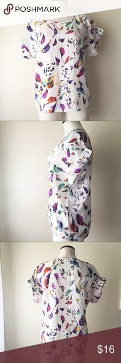 Boutique Style Blouse Boutique style Blouse with no brand name size L. Features little birds throughout and a roll cuff sleeve. Tops Blouses