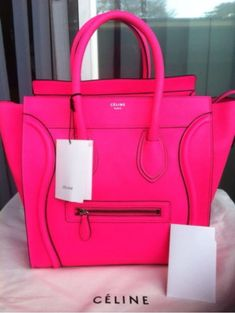 It almost hurts my eyes to look at this amazing beyond neon pink Celine  mini handbag but I can t look away either! 081962d61d501