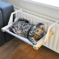 *DESIGN WITH THOUGHT* The Woozy Pet Hammock is an easy to install hammock for your cat or little dog. This hammock can easily be hooked onto a radiator or placed on the floor. Give your pet a...