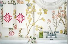 Wallpaper and monogrammed hand-towels