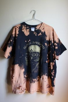 This shirt is a one of a kind, each splattered shirt is different.  This one is a Black Sabbath gas mask 78 tour tee , all cotton.  Splatter bleach