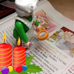 Mrs.Claus is searching a new recipe for christmas cookies :) #Playmobil #toyphotography #plasticculture #christmas #seasonsgreeting #mrsclaus #bakery #cookies #clipart #advent