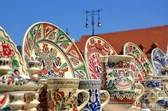 Photo about Traditional Romanian pottery during a traditional fair in Sibiu/Hermannstadt. Image of homemade, bowl, factory - 26425832 Types Of Ceramics, Visit Romania, Carpathian Mountains, Medieval Town, Bucharest, Serbian, Kirchen, Traditional Art, Folk Art