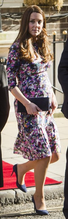 At a lunchtime celebration, Darla dress by Erdem, Russell and Bromley Muse clutch, McQueen pumps