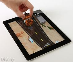 This just looks like too much fun for a kid.  Disney's Cars toys and app that turns the iPad into a game board!