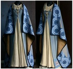 Open fronted apron dress with cloak.