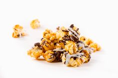 Chocolate drizzled caramel gourmet popcorn will satisfy all