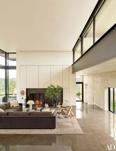 In the living room, the steel fireplace surround is framed in eggshell-veneer panels by Chapeau Design | archdigest.com