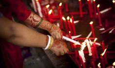 Hindu women offers prayers as part of Durga Puja festival at the national temple in Dhaka Bangladesh