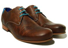 John Fluevog CBC Radio derbys. They look and smell like well-oiled leather, and those electric blue laces and stitching stand out nicely. Good to wear with jeans or casual business dress.