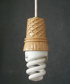 Ice Cream Lamp.  It actually makes the bulb look attractive... now that is design genius! @Laura Jane