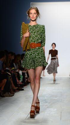 Loving the green... nice long sleeve with a flirty skirt.