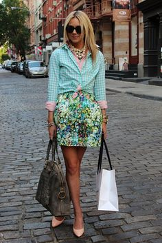i love the different prints put together and the fact that this is a dress being worn as a skirt. #wouldlovetowearthis