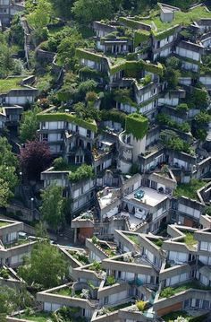 Greening roofs at Jean Renaudie's housing complex in Ivry sur Seine, France. So cool!