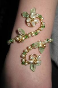 This is gorgeous!  So different and beautiful!    Handmade wire wrap Cuff Bracelet.  Glass pearls, Czech leaf