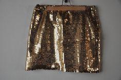 Tonnelet: falda corta dorada