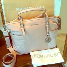 "Diaper BABY BAG Michael Kors Jet Set NWT! Blush Gorgeous 100% Authentic diaper bag. Blush color combined with silver hardware.  Comes with changing pad. Paper work and tags are attached.  Perfect new condition.  Long strap is adjustable and detachable as well.  Measurements: L16.5""/ H11.5"" Handles: 10"" Drop Strap: 14""/22""  Material Pale Pink/Blush color  Retail price: $298 Michael Kors Bags Shoulder Bags"